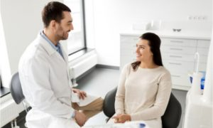 patient and doctor discussing holistic dental hygiene